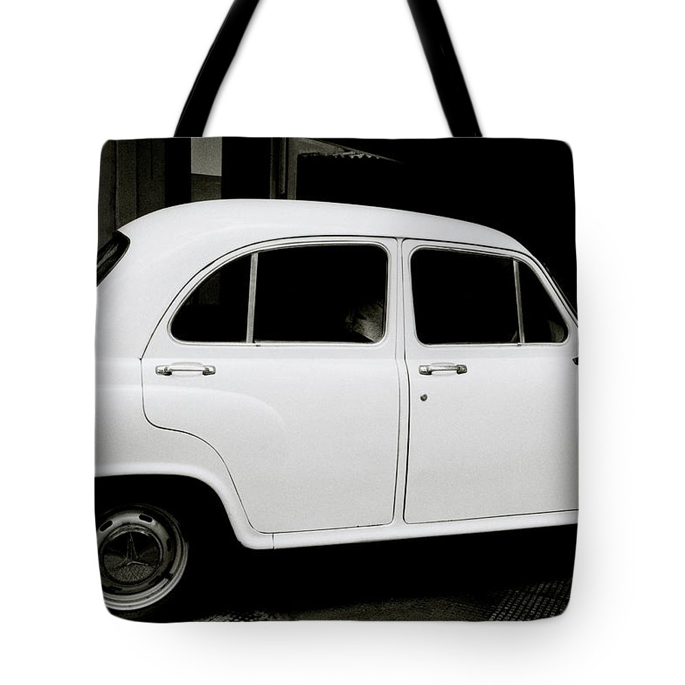 Hindustan Tote Bag featuring the photograph The Ambassador by Shaun Higson
