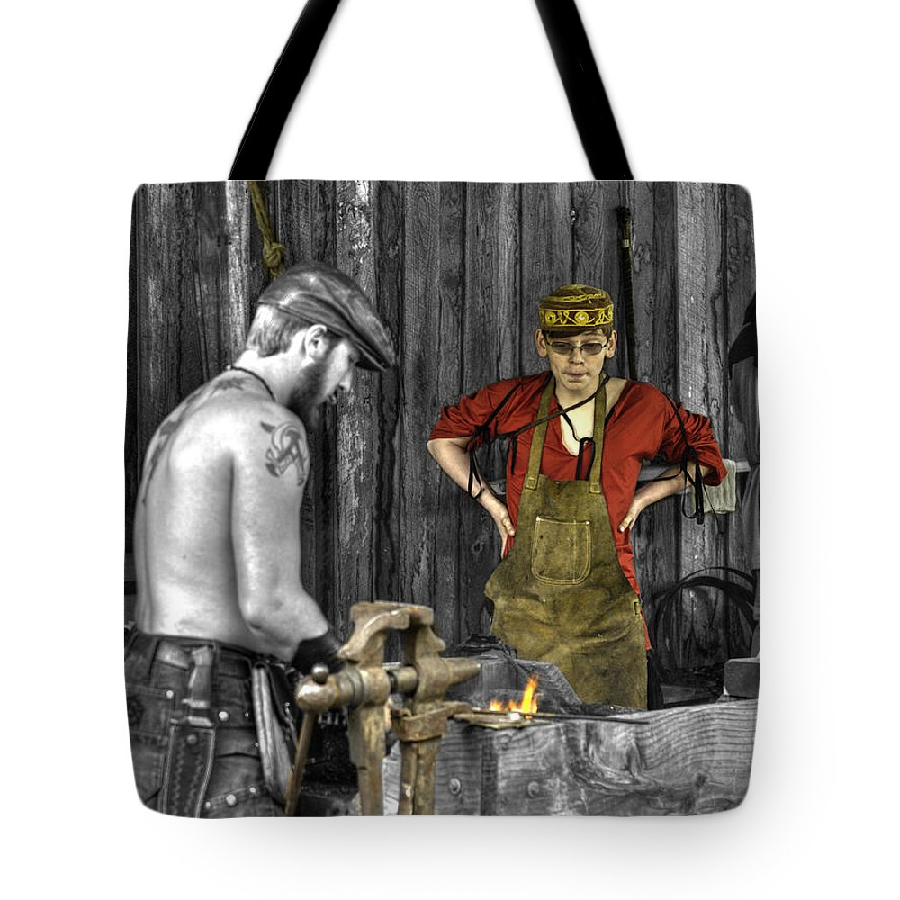Blacksmith Working Iron Tote Bag featuring the photograph The Apprentice Blacksmith Armorer by John Straton