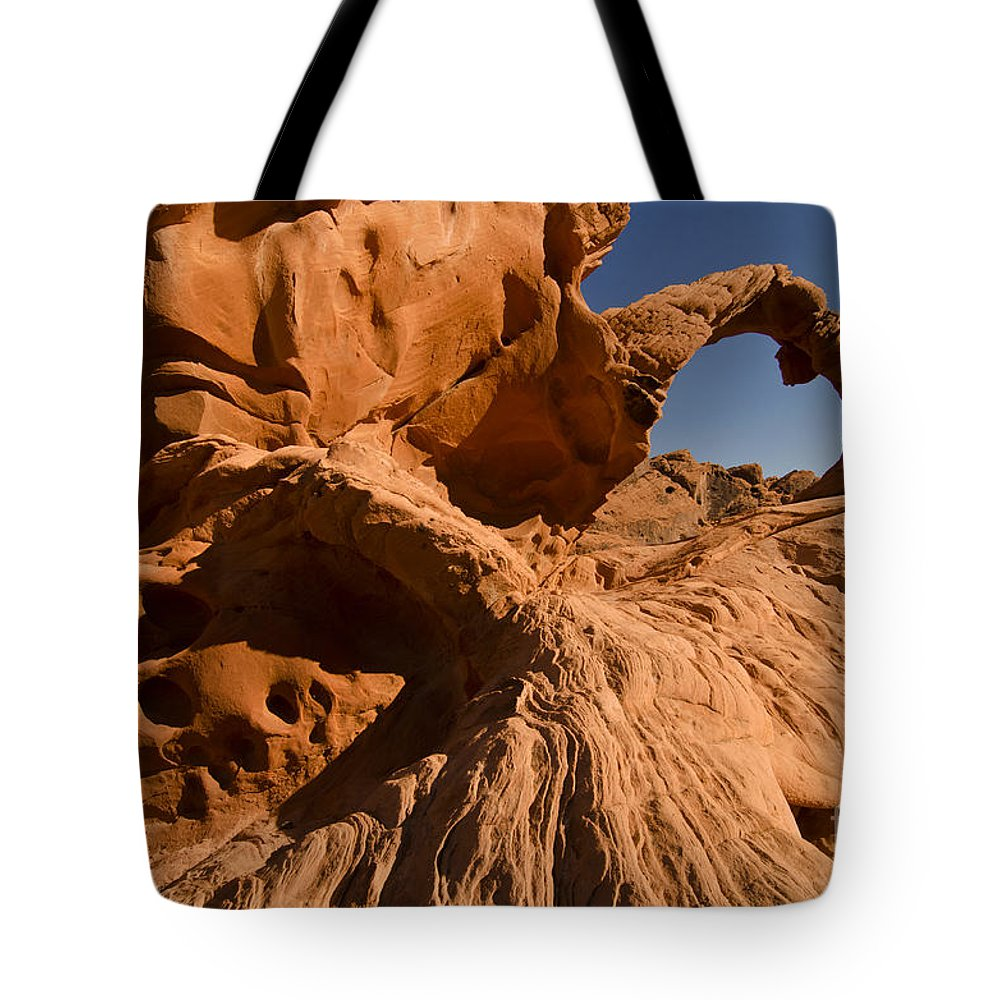 Arch Tote Bag featuring the photograph The Arch by Mike Nellums