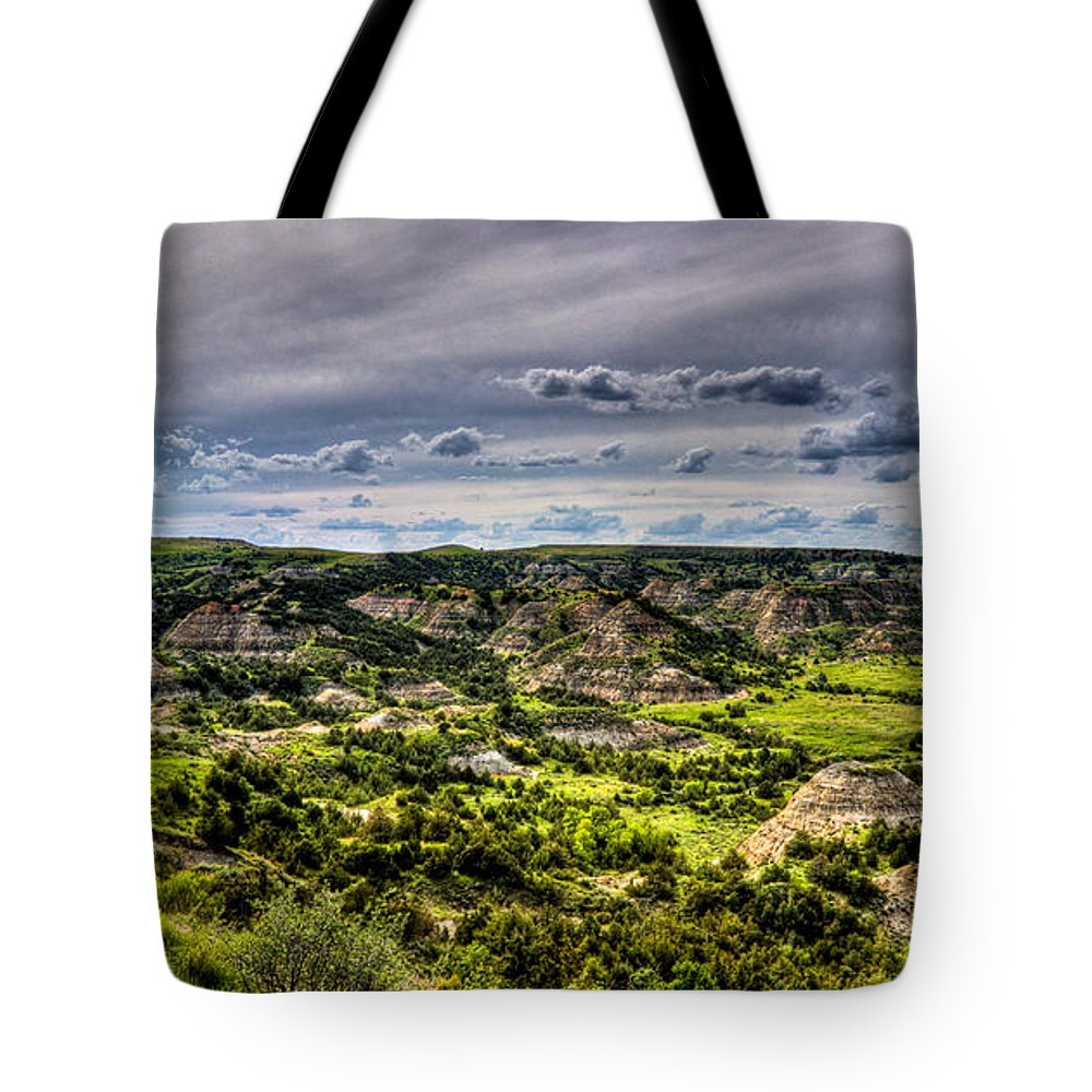 Badlands Tote Bag featuring the photograph The Badlands by Jonny D