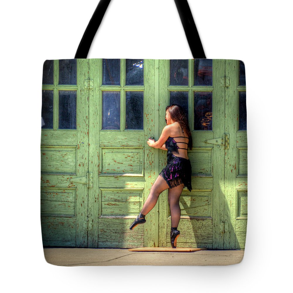 Street Scene Tote Bag featuring the photograph The Ballerina And The Green Doors by M Dale