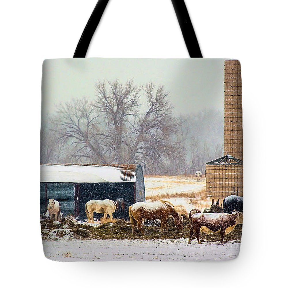A Barn Yard Captured With The Snowing Falling. Tote Bag featuring the photograph The Barn Yard by Steven Reed