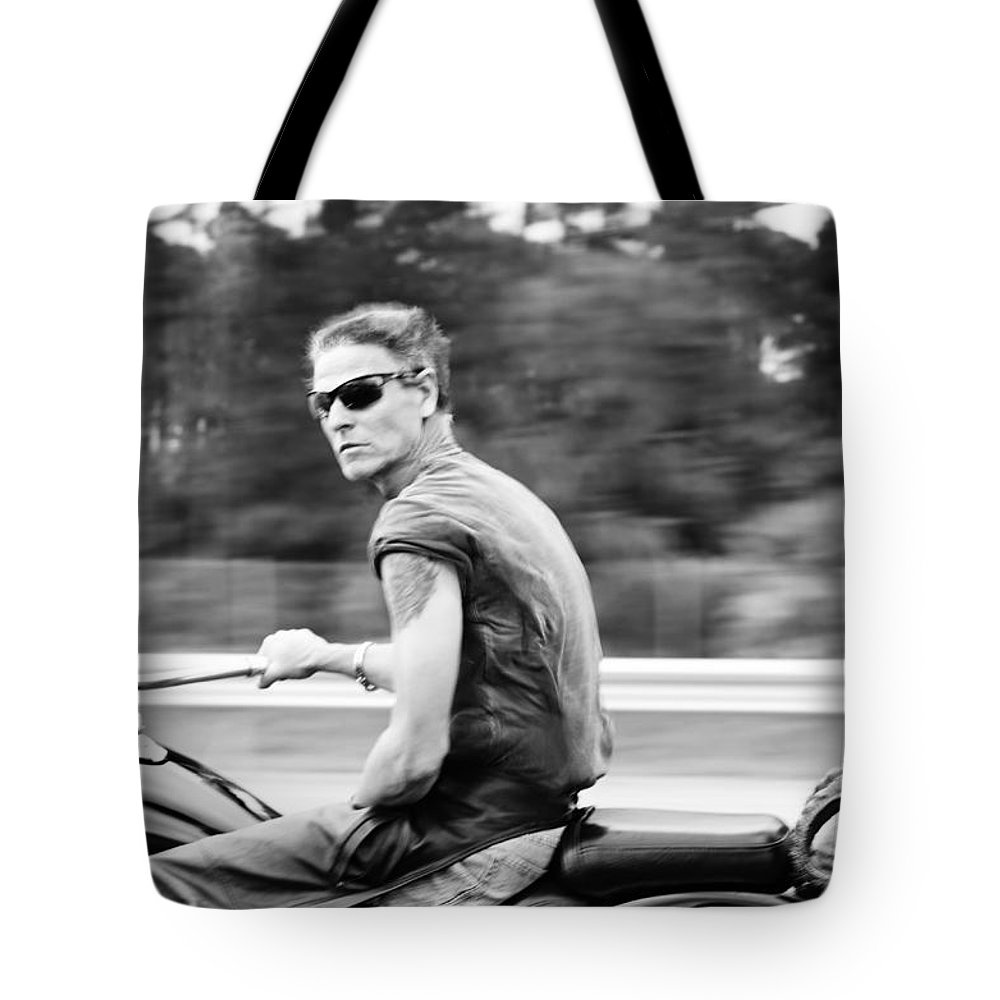 Biker Tote Bag featuring the photograph The Biker by Laura Fasulo