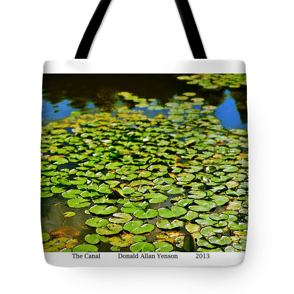 Lillies Tote Bag featuring the photograph The Canal by Donald Yenson