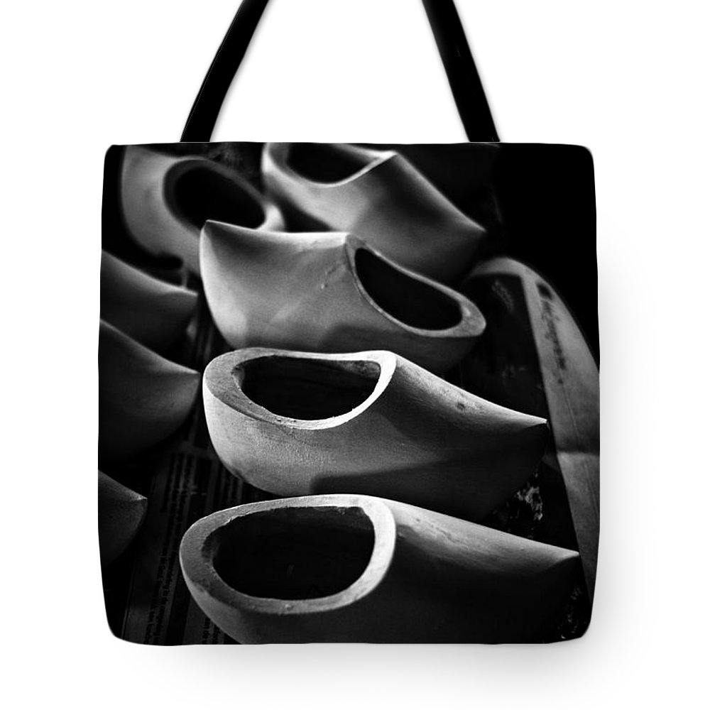 Wooden Shoes Tote Bag featuring the photograph The Clog Shop by Brothers Beerens