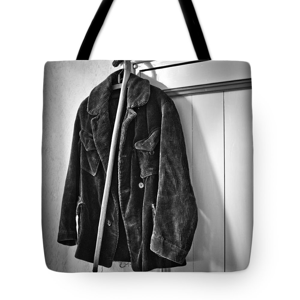 Coat Tote Bag featuring the photograph The Coat And The Cane by Brothers Beerens