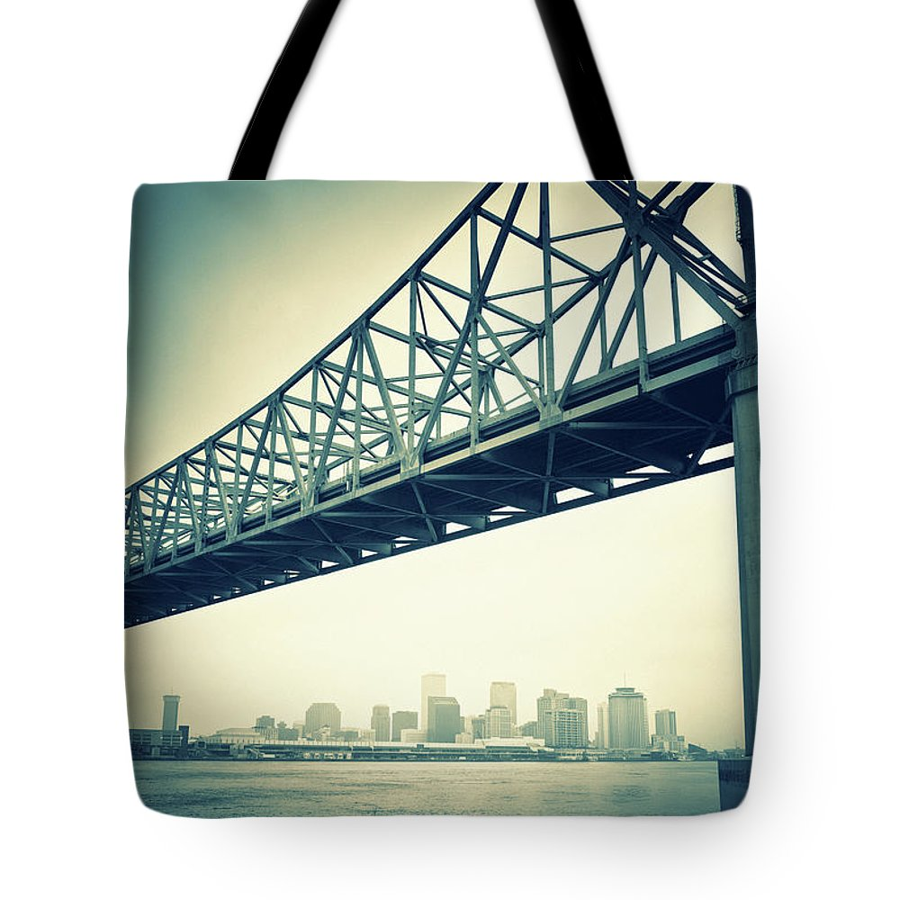 Desaturated Tote Bag featuring the photograph The Crescent City Connection In New by Moreiso
