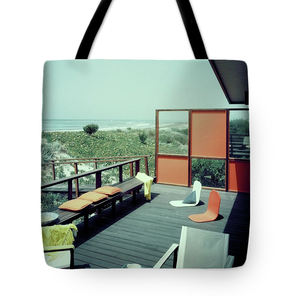 Architecture Tote Bag featuring the photograph The Deck Of A Beach House by George De Gennaro