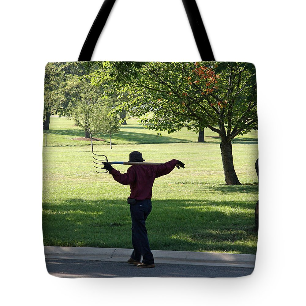Devil Tote Bag featuring the photograph The Devil And His Pitchfork by Cora Wandel