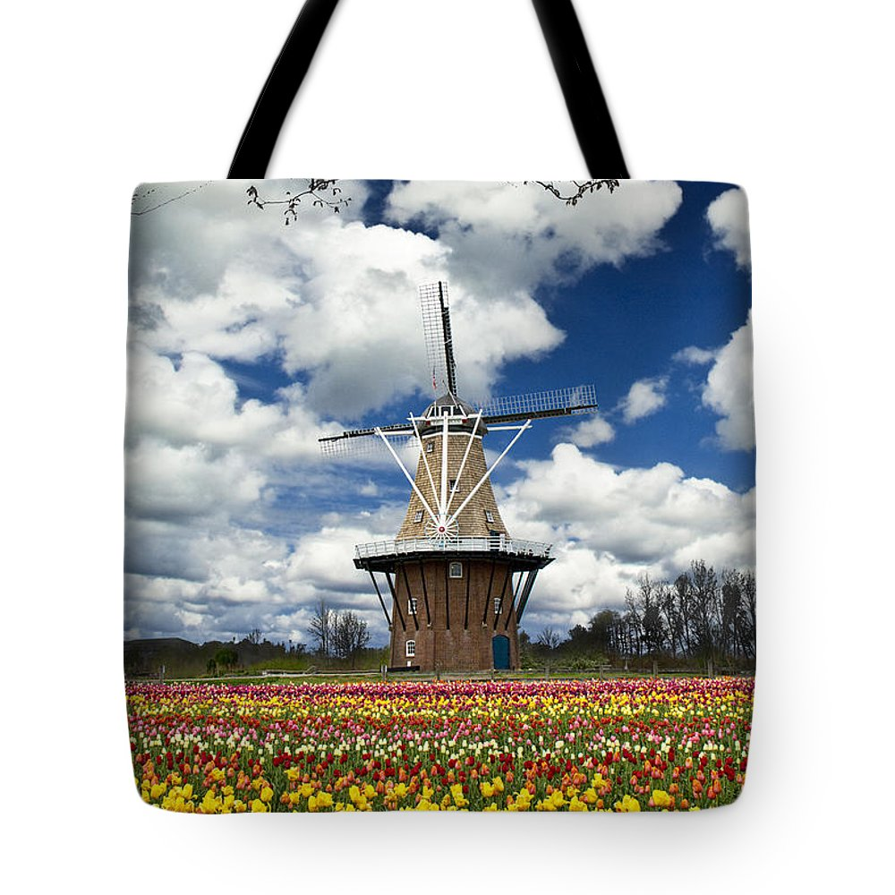 Art Tote Bag featuring the photograph The Dezwaan Dutch Windmill Among The Tulips On Windmill Island In Holland Michigan by Randall Nyhof
