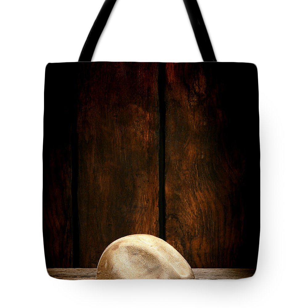 Cowboy Hat Tote Bag featuring the photograph The Dirty Tan Hat by Olivier Le Queinec