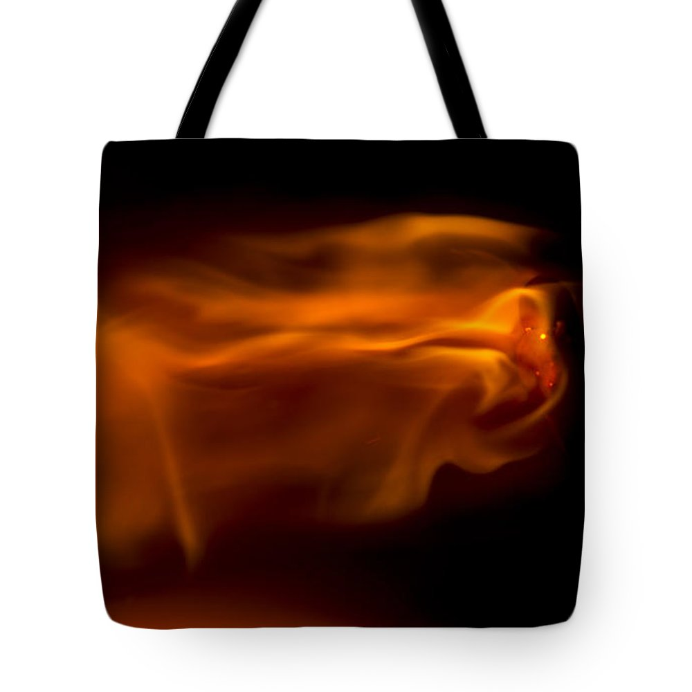 Ignition Tote Bag featuring the photograph The Eagle by Steven Poulton
