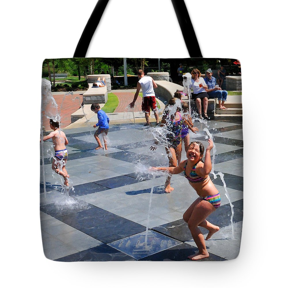 Child Playing In Water Fountain Tote Bag featuring the photograph Joyful Young Girl Playing In Fountain by Ginger Wakem