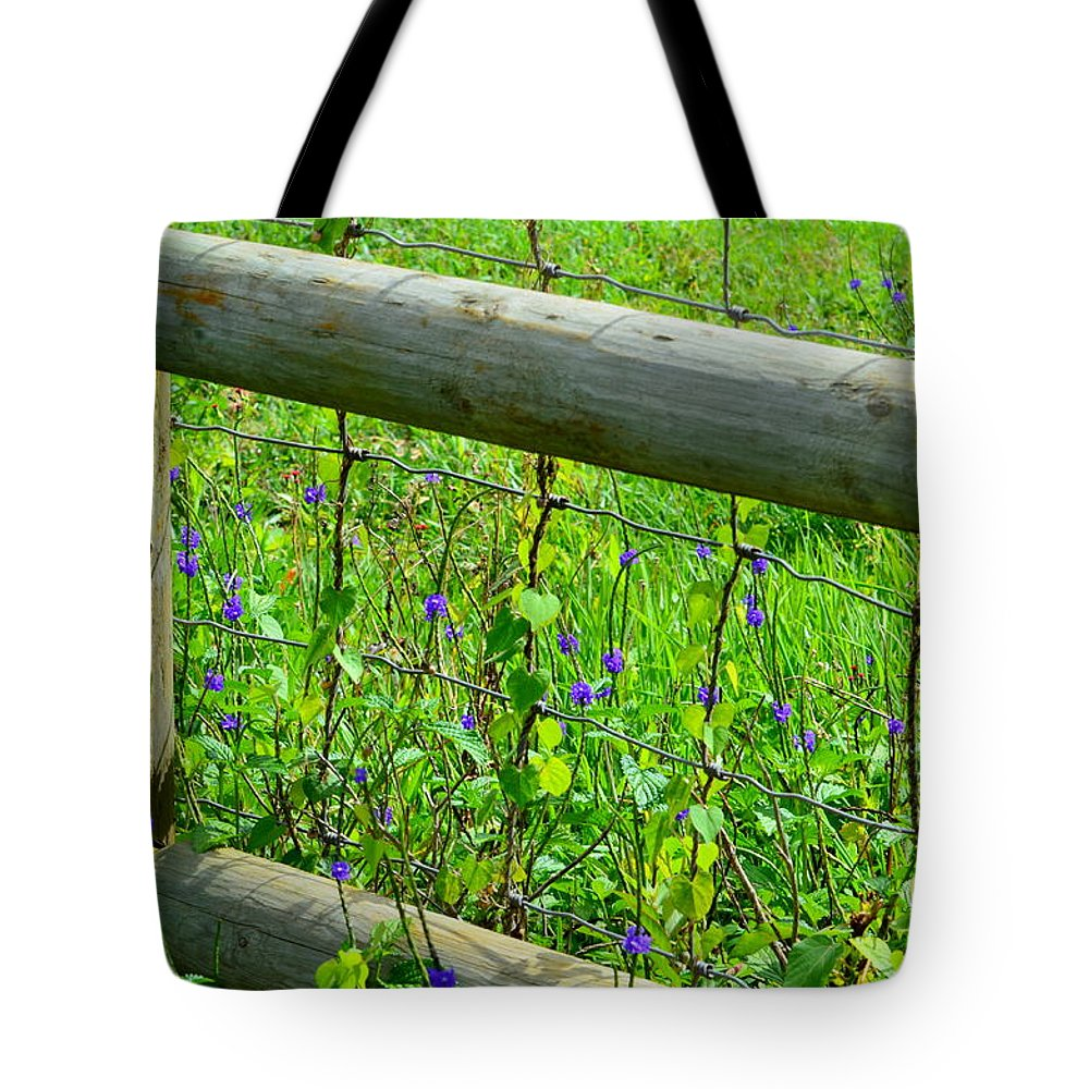 Fence Tote Bag featuring the photograph The Fence At The Meadow by Mary Deal