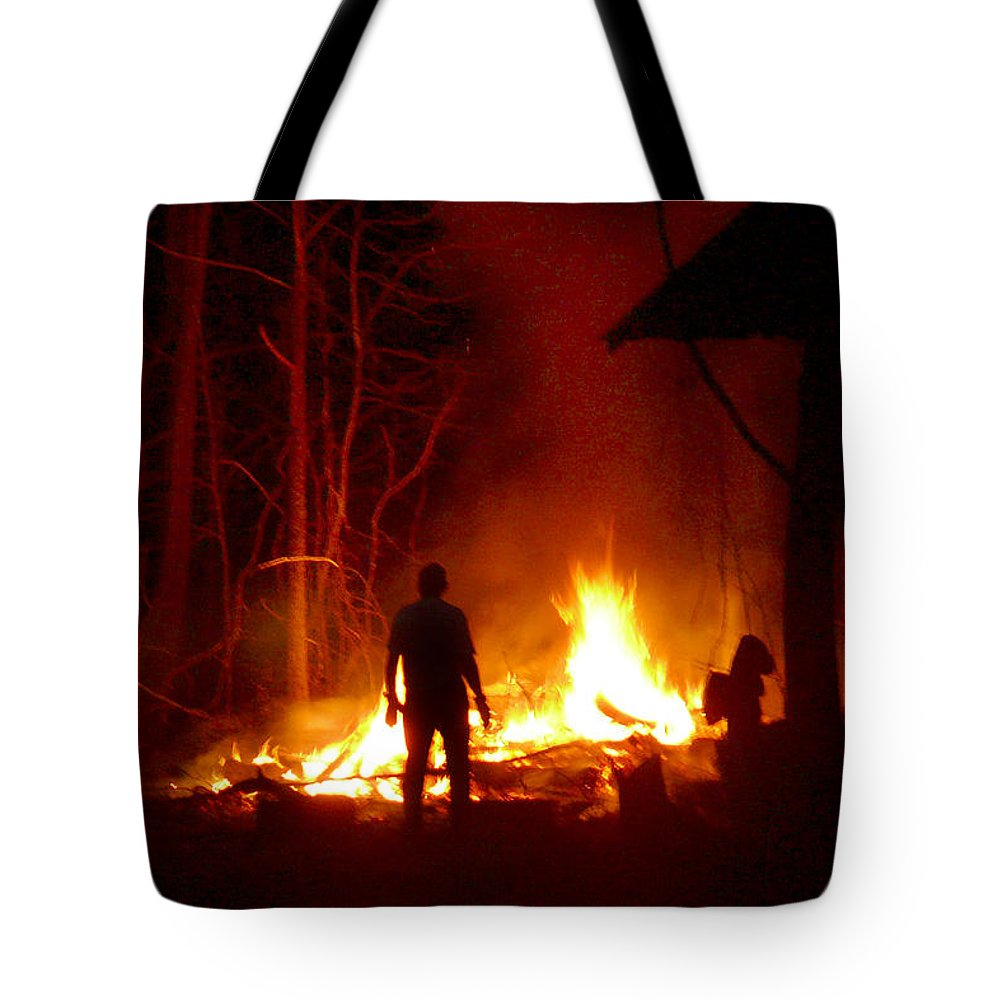 Fire Tote Bag featuring the photograph The Fire Starter by Mike McGlothlen
