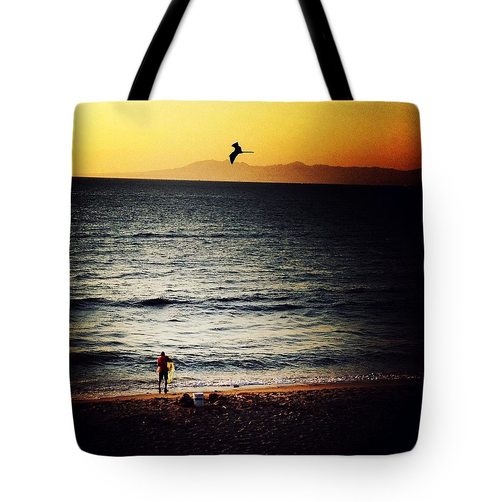 Fisherman Tote Bag featuring the photograph The Fisherman And His Shadow by Natasha Marco