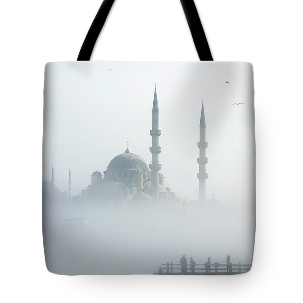 Istanbul Tote Bag featuring the photograph The Galata Bridge Leads Across Golden by Jazzirt