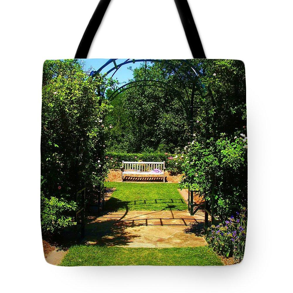 Garden Tote Bag featuring the photograph The Garden Bench by Venus