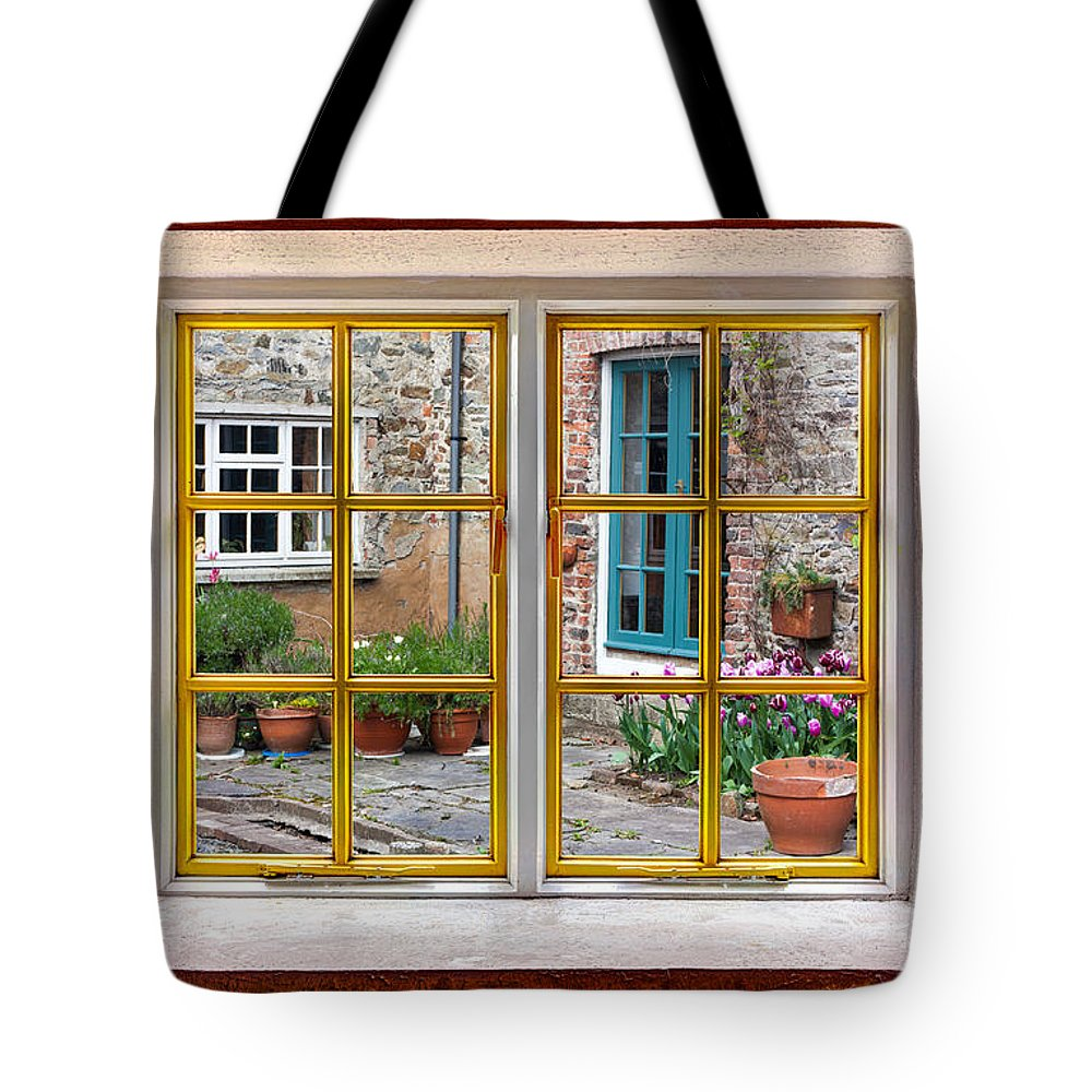 Grass Tote Bag featuring the photograph The Garden by Semmick Photo