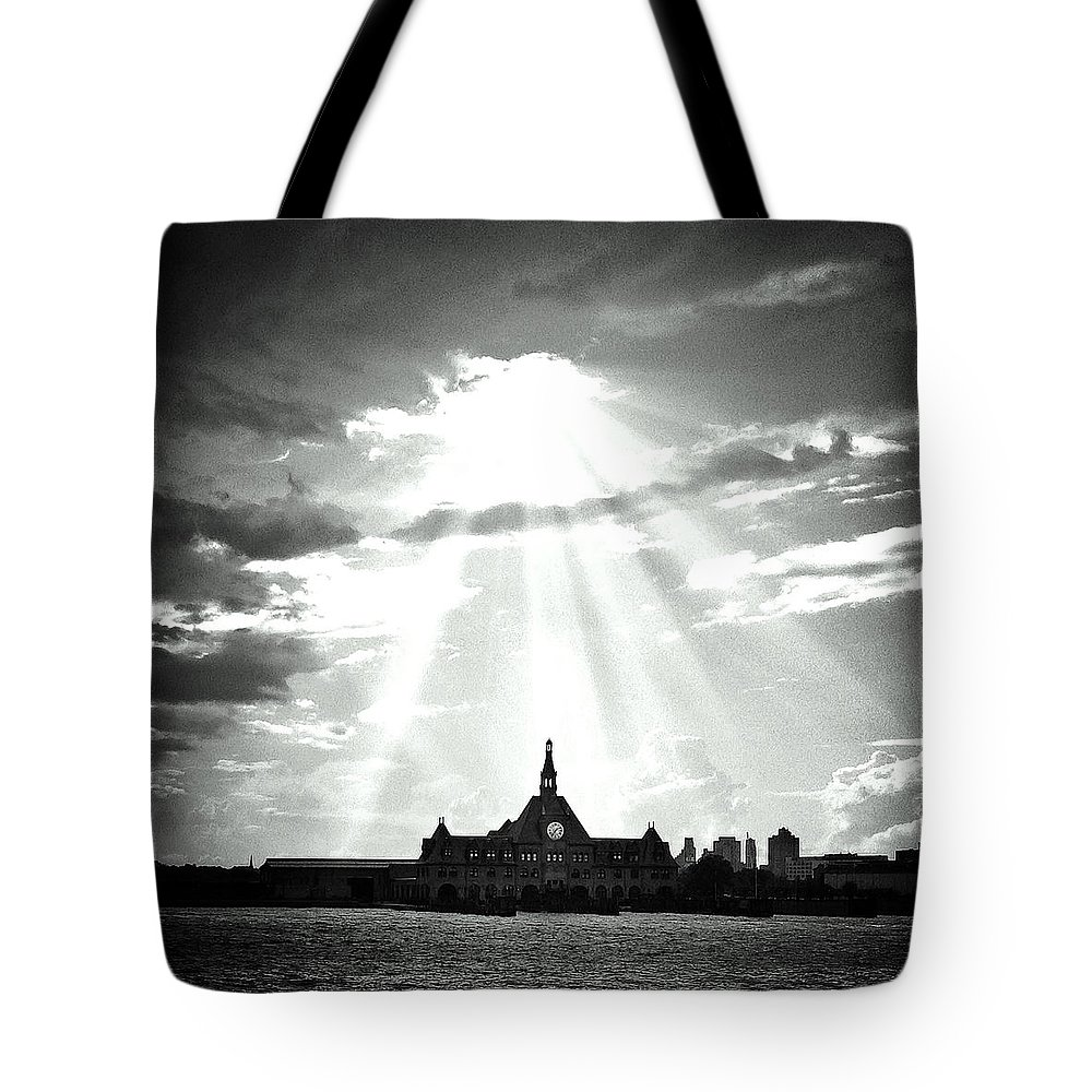Ellis Island Tote Bag featuring the photograph The Gateway Of Generations by Natasha Marco
