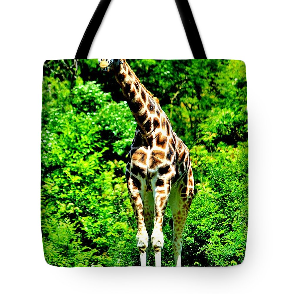 Giraffe Tote Bag featuring the photograph The Giraffe by Benjamin Yeager