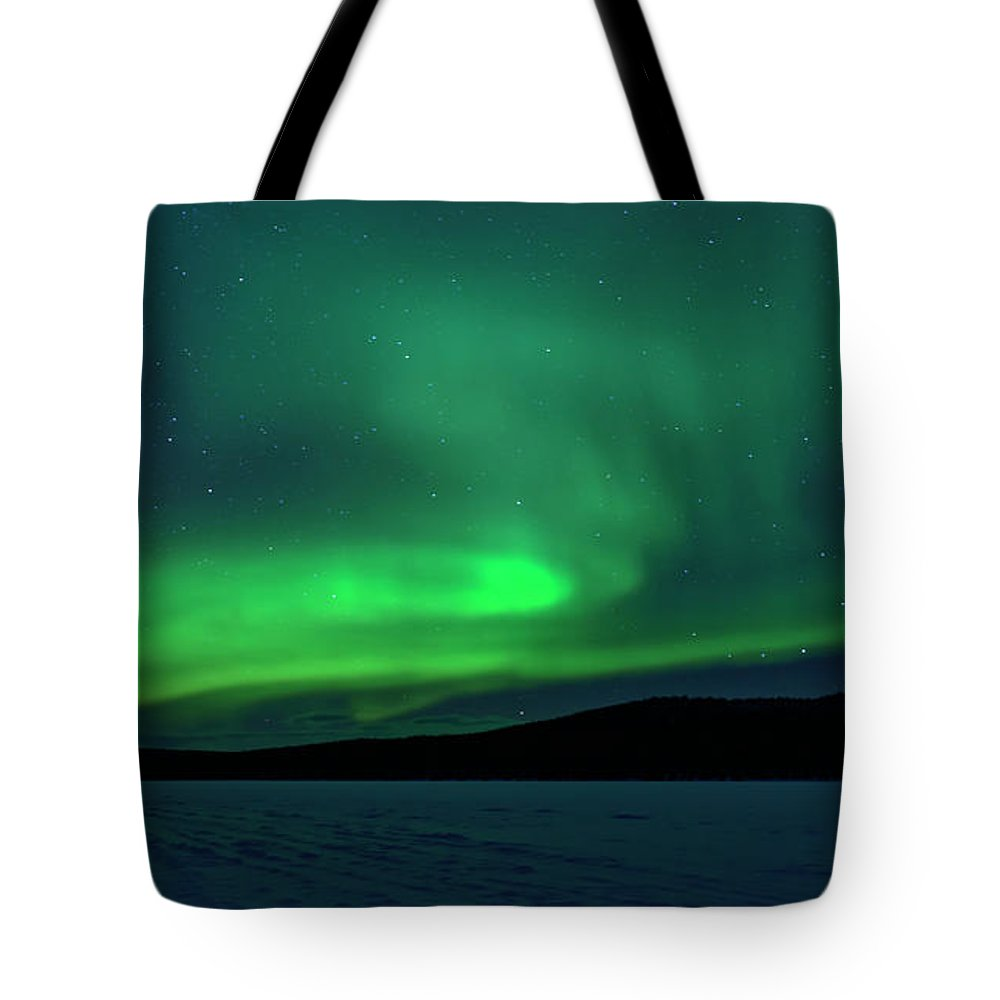 Snow Tote Bag featuring the photograph The Green Light Of The Aurora by Dave Moorhouse