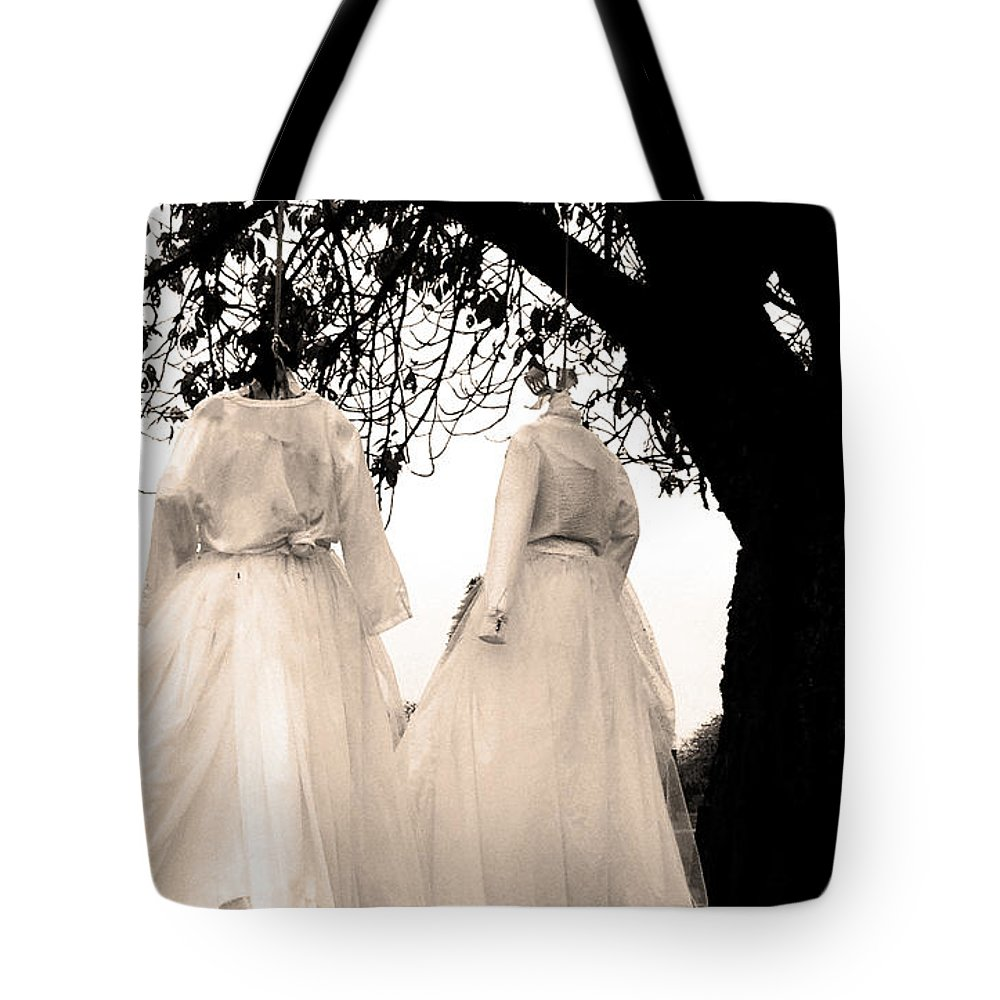 Black And White Tote Bag featuring the photograph The Hanging Brides by The Artist Project