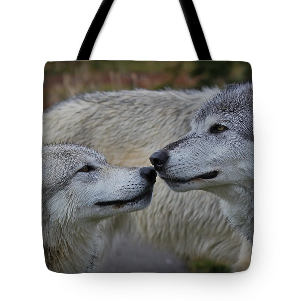Wolves Tote Bag featuring the photograph The Kiss by Athena Mckinzie