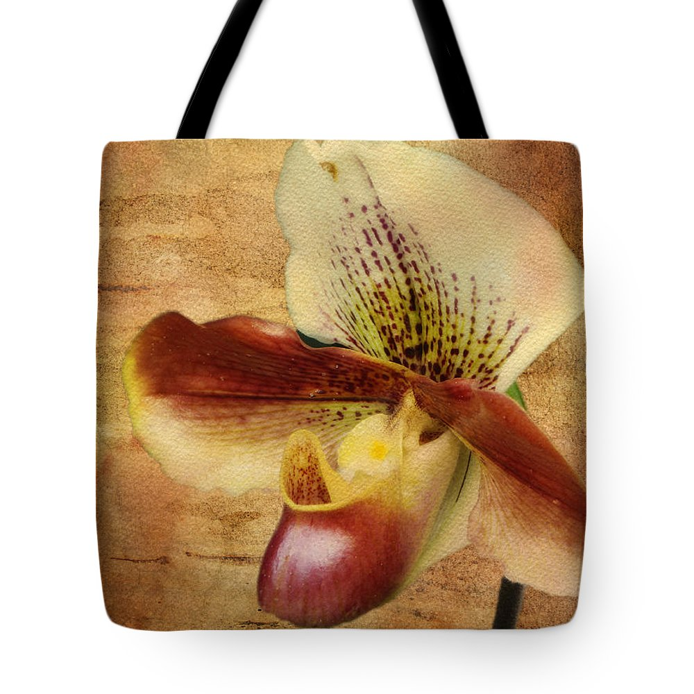 Botanicals Tote Bag featuring the photograph The Lady Slipper Orchid by Linda Dunn