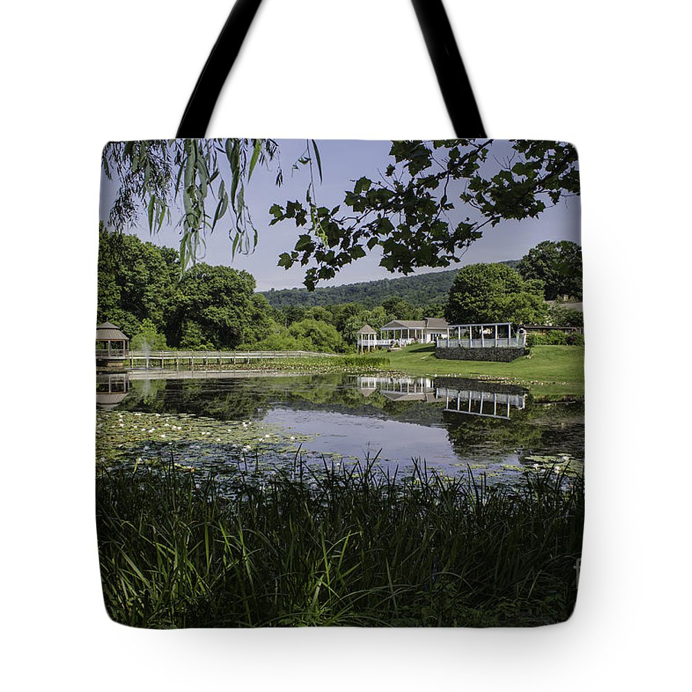 Landscape Tote Bag featuring the photograph The Lily Pond by Arlene Carmel