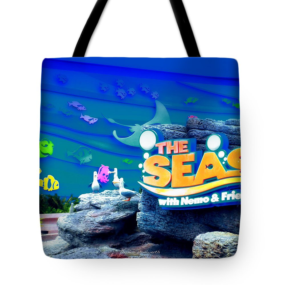 The Living Seas Tote Bag featuring the photograph The Living Seas Signage Walt Disney World by Thomas Woolworth