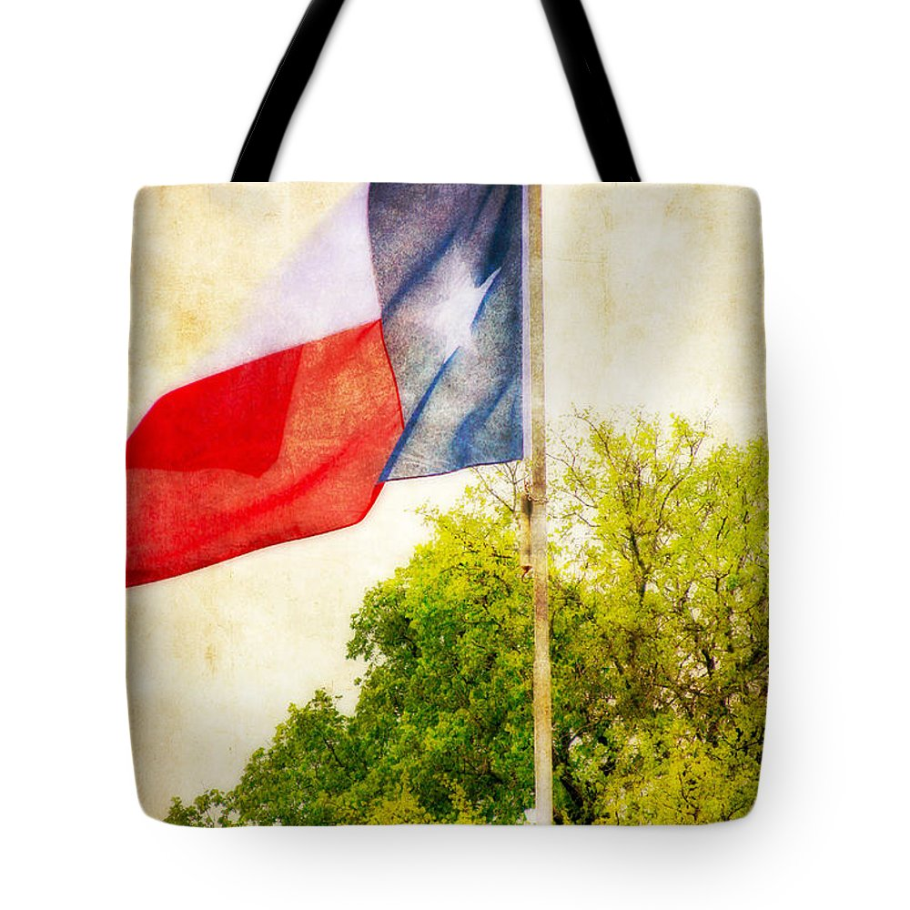 Flag Tote Bag featuring the photograph The Lone Star Flag by Joan Bertucci