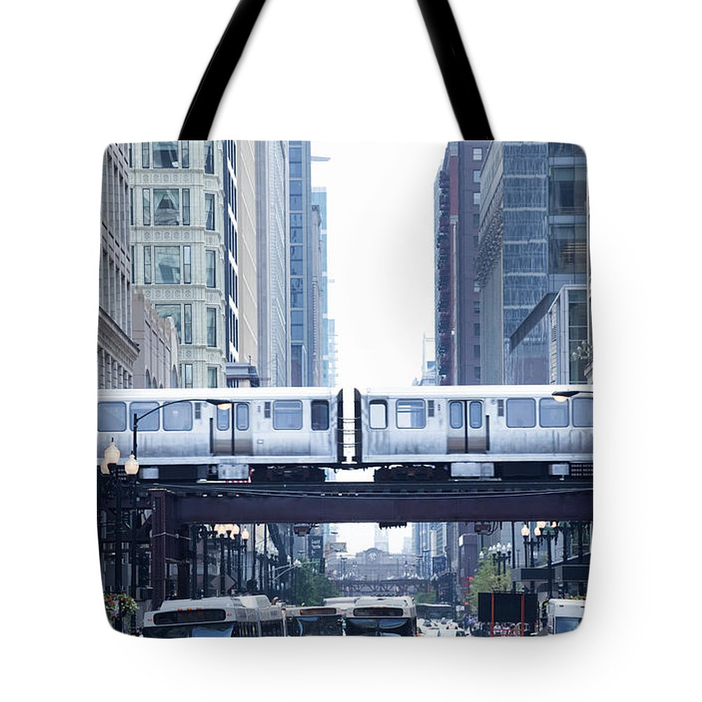 Scenics Tote Bag featuring the photograph The Loop And El Train In Chicago by Yinyang