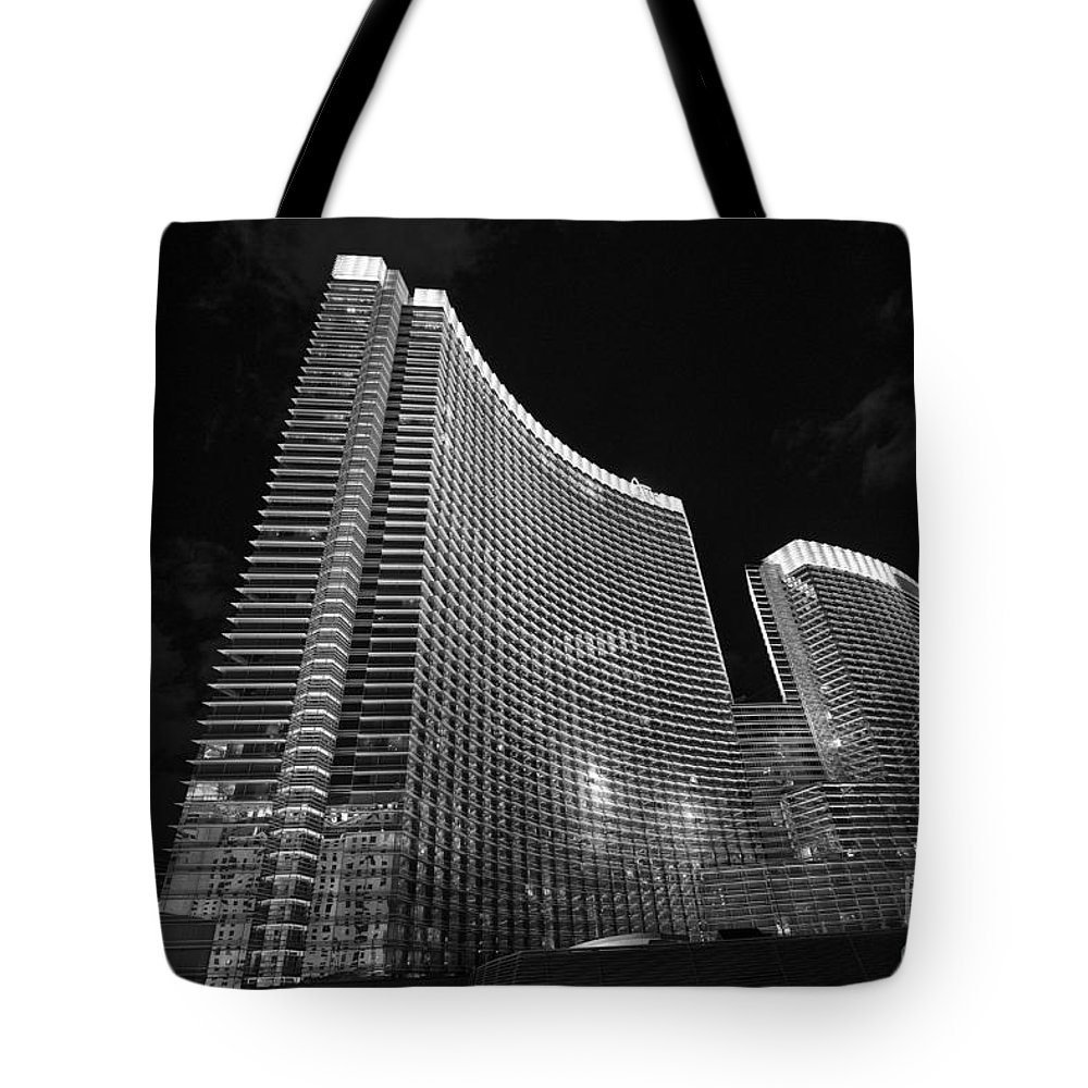 Aria Resort Tote Bag featuring the photograph The Magnificent Aria Resort And Casino At Citycenter In Las Vegas by Jamie Pham