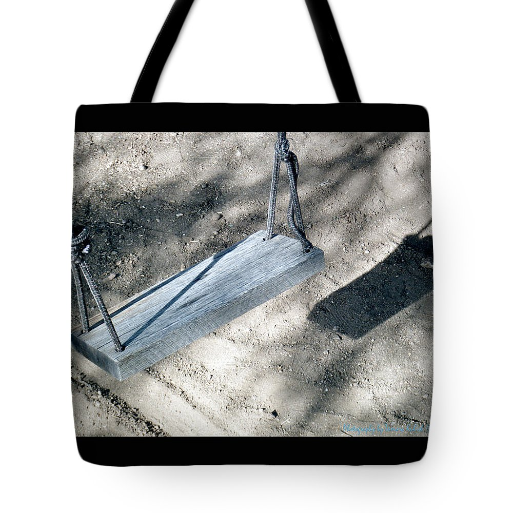 Swing Tote Bag featuring the photograph The Memories Of This Old Swing2 by Tamara Kulish