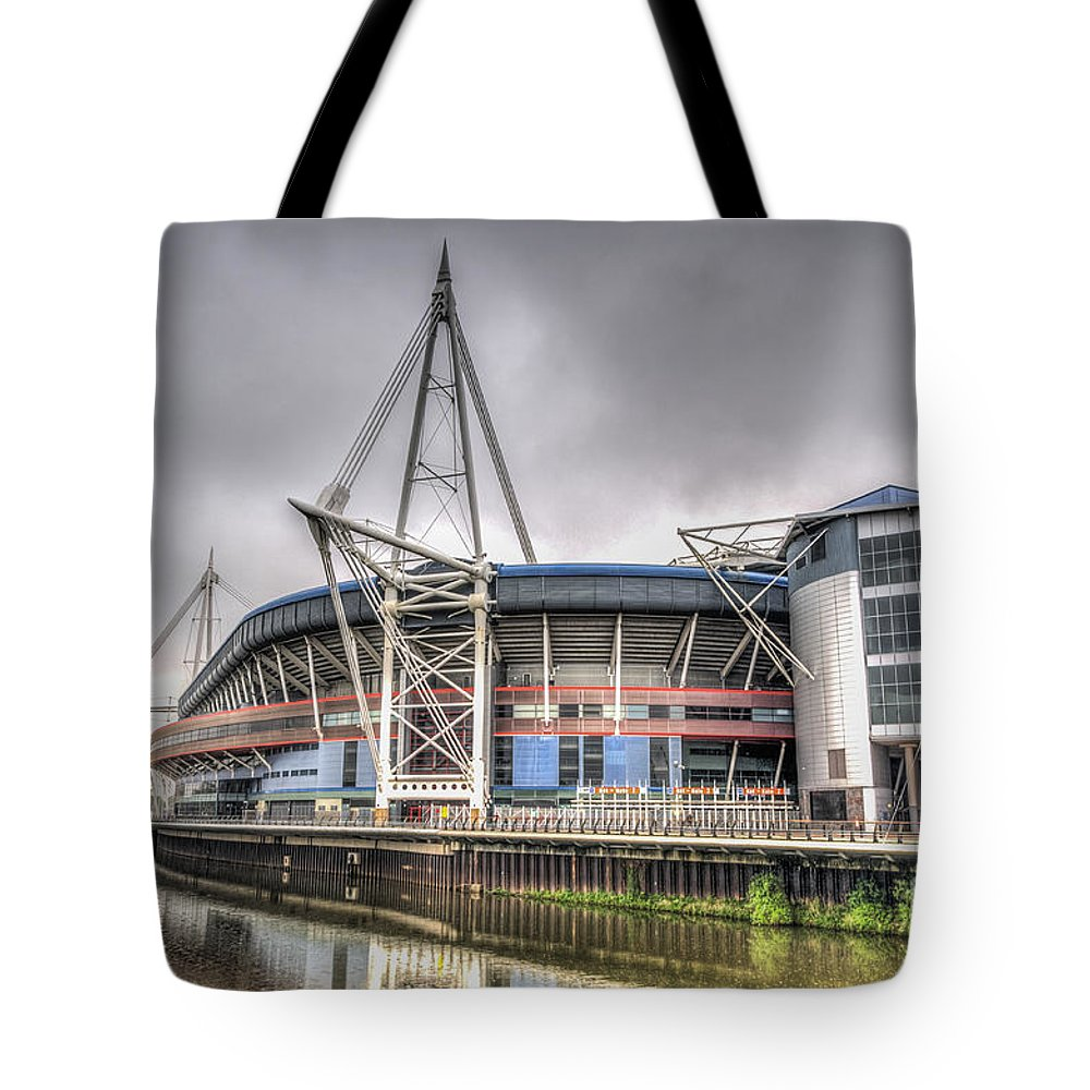 The Millennium Stadium Tote Bag featuring the photograph The Millennium Stadium by Steve Purnell