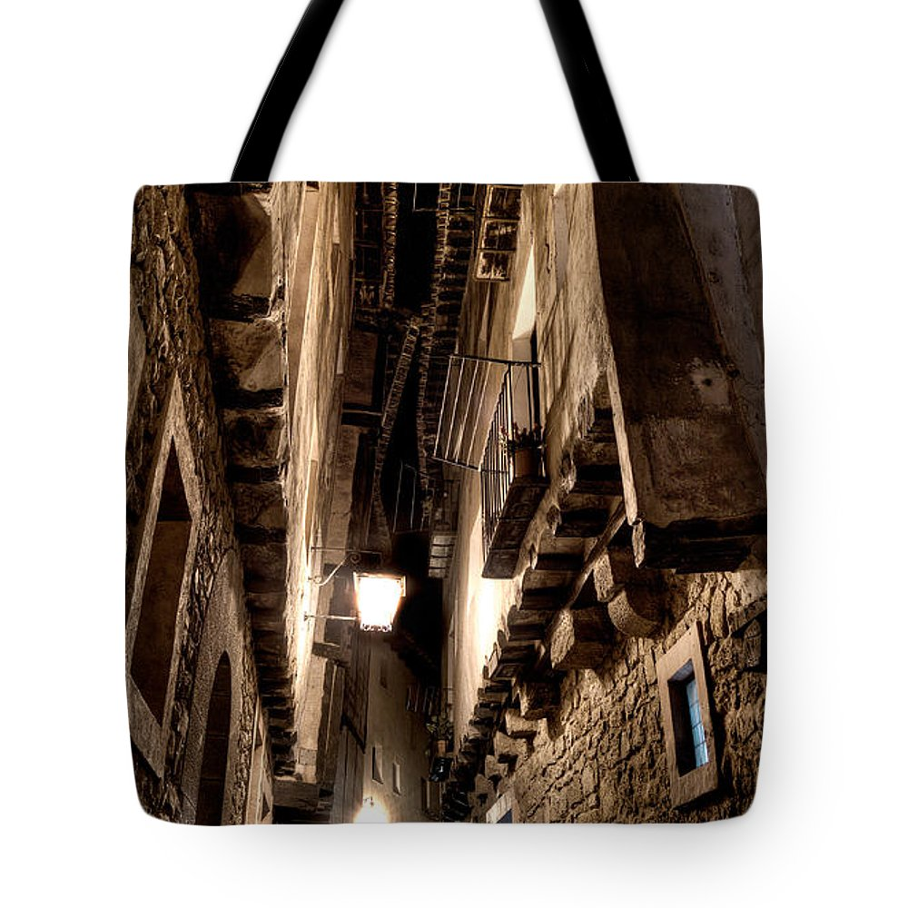 Narrow Street Tote Bag featuring the photograph Narrow Street In Albarracin by Weston Westmoreland