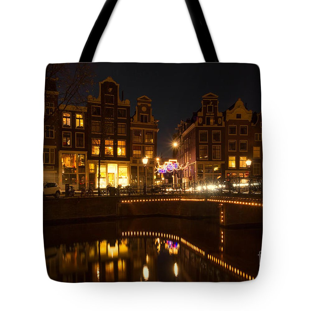 Amsterdam Tote Bag featuring the photograph The Nine Streets Amsterdam by Ann Garrett