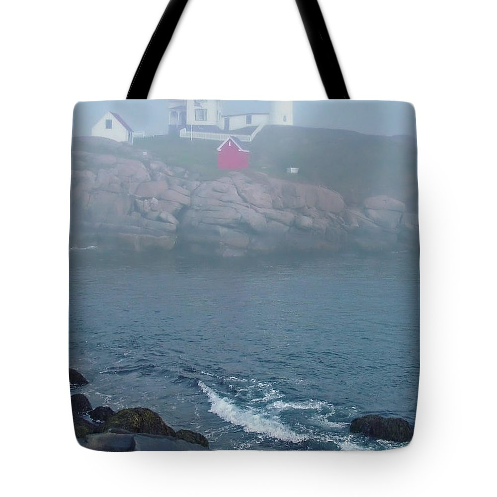 Nubble Lighthouse Tote Bag featuring the photograph The Nubble Lighthouse At York Maine by Suzanne Gaff