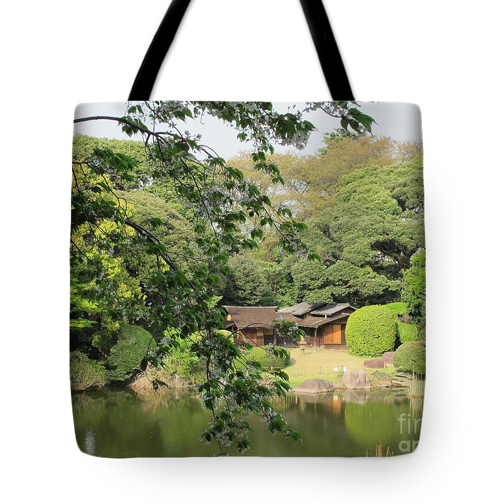 The Tote Bag featuring the photograph the old Japanese House by the water by Seija Talolahti