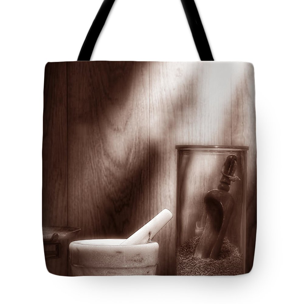 Antique Tote Bag featuring the photograph The Old Lavender Artisan Shop In Sepia by Olivier Le Queinec