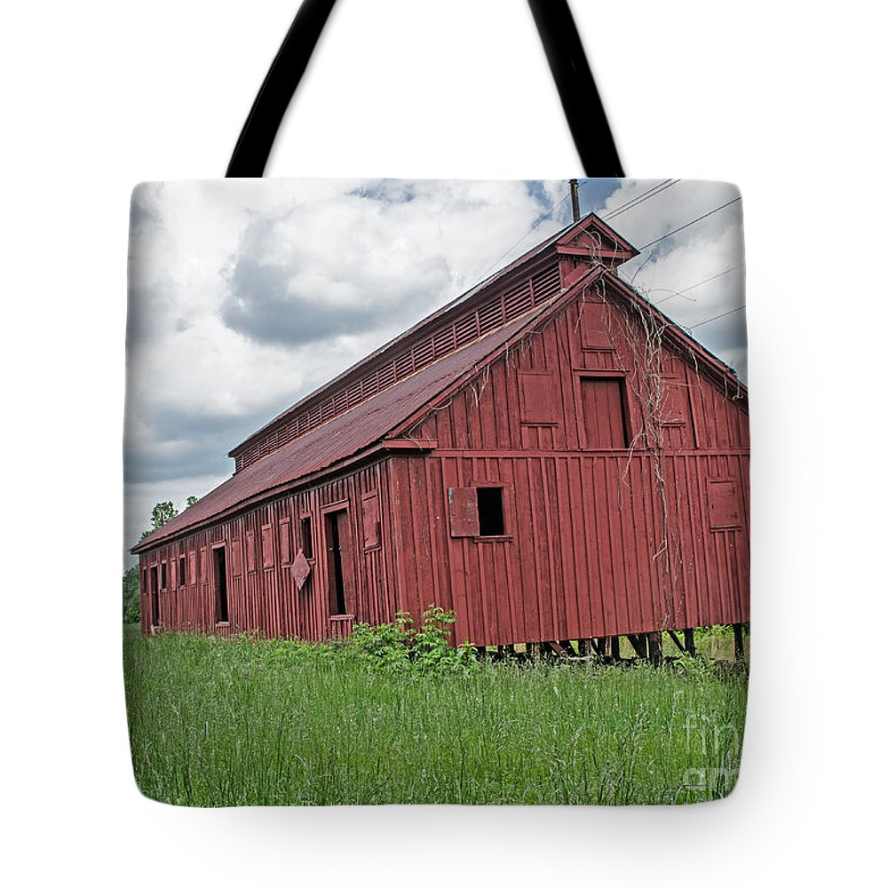 Barn Tote Bag featuring the photograph The Old Abandon Tobacco Barn by Donna Brown