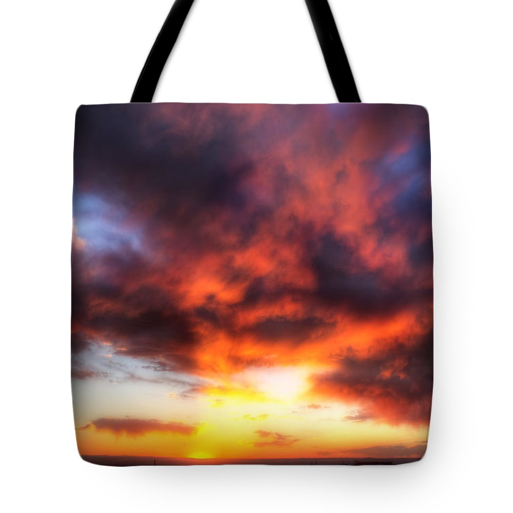 Sky Clouds Sunset Red Orange Blue Yellow Horizon Sw Southwest new Mexico Nm Sw Southwest Albuquerque roch Hart Tote Bag featuring the photograph The Other Evening by Roch Hart