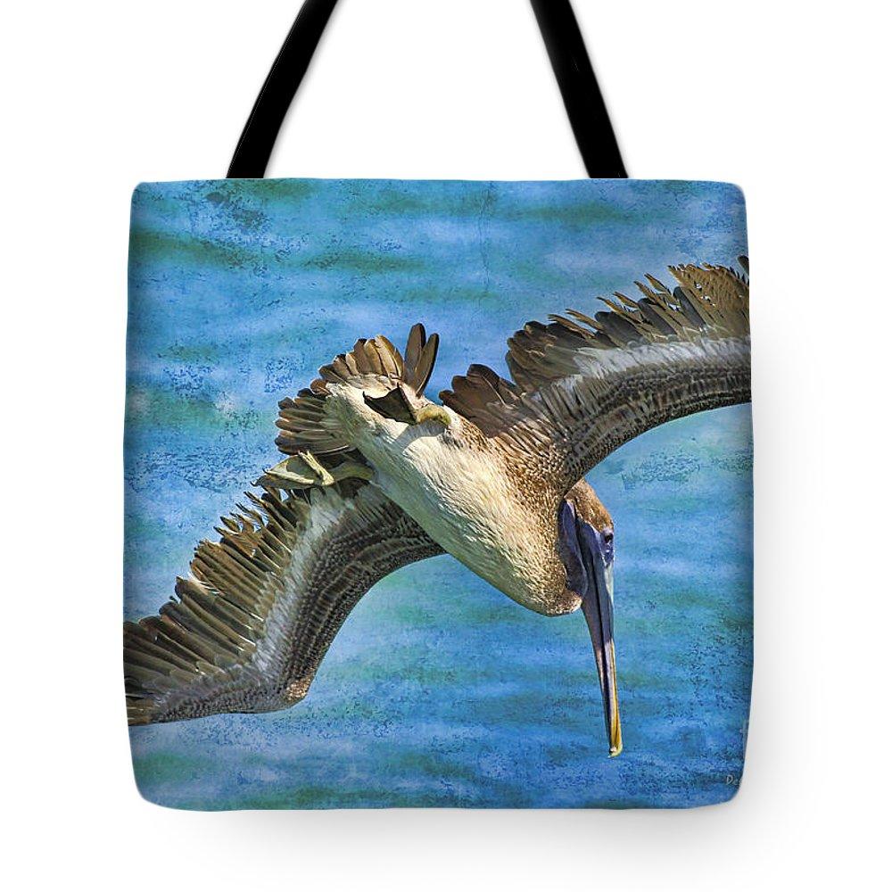 Pelican Tote Bag featuring the photograph The Peli Dive by Deborah Benoit