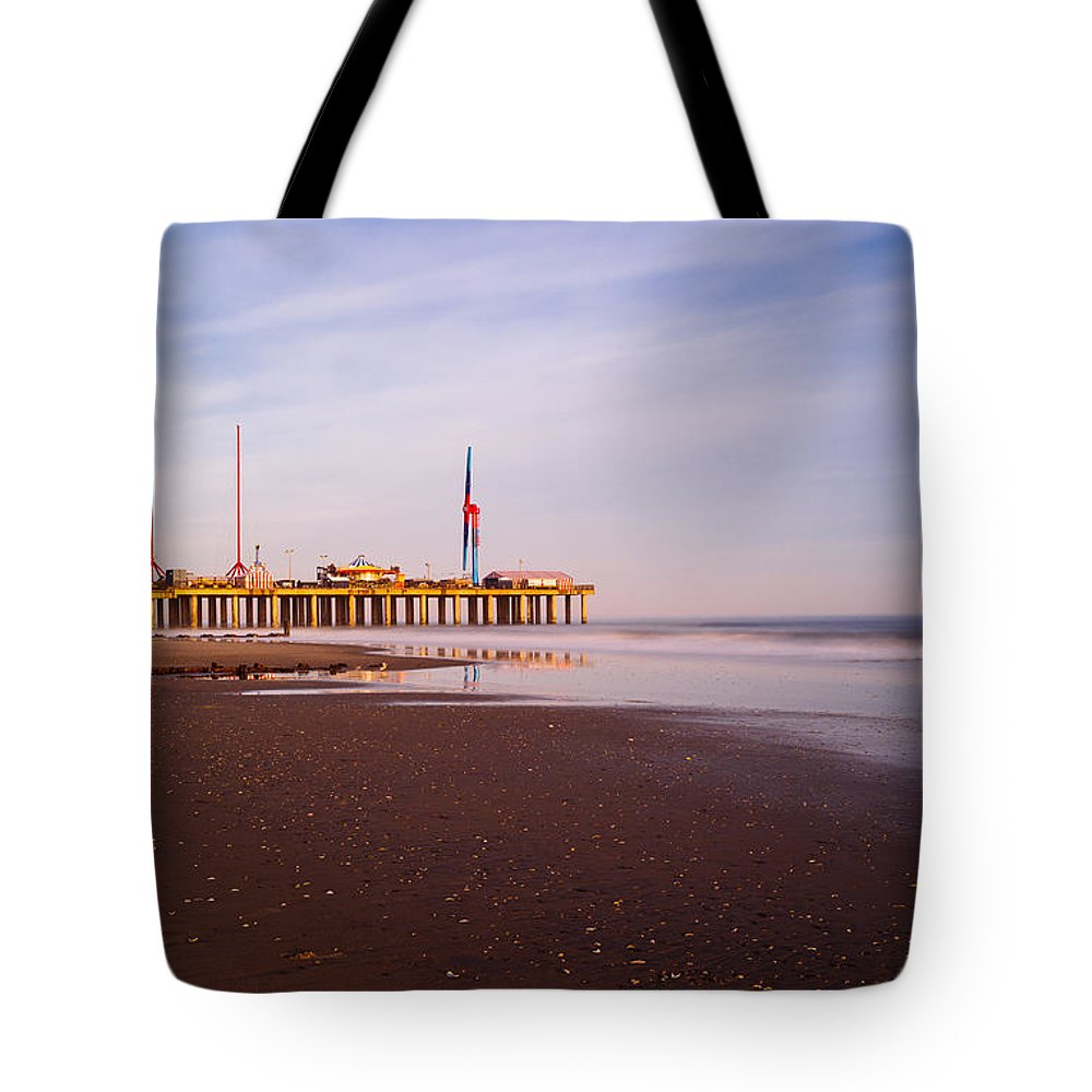 Landscape Tote Bag featuring the photograph The Pier by Roman Kruglov