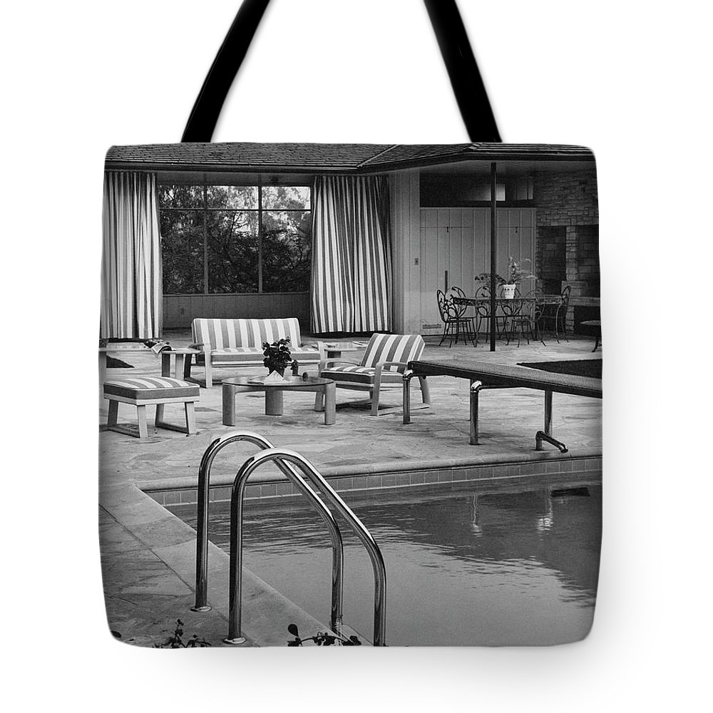 Architecture Tote Bag featuring the photograph The Pool And Pavilion Of A House by Sharland