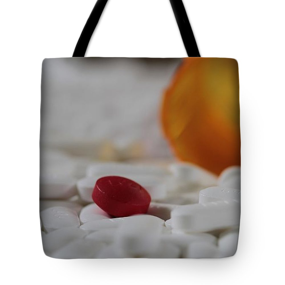 The Red Pill Tote Bag featuring the photograph The Red Pill by Dan Sproul