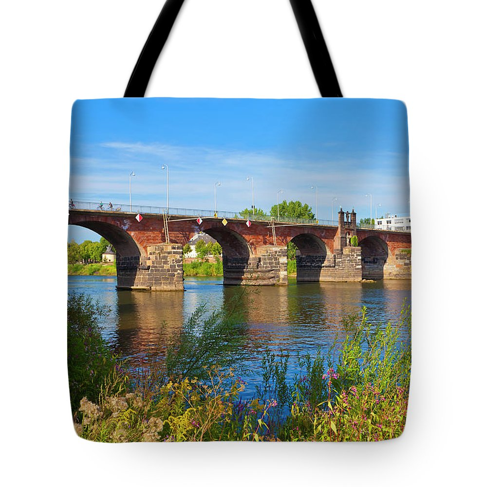 Roman Tote Bag featuring the photograph The Roman Bridge Over Mosel River In by Werner Dieterich