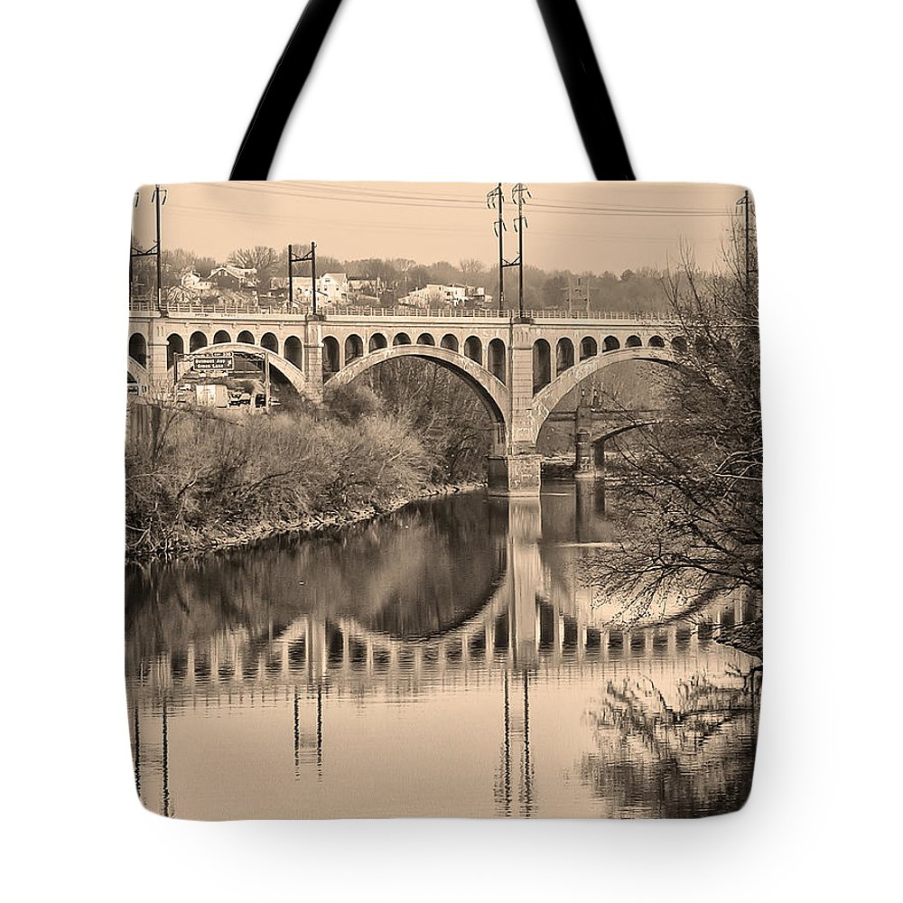 Schuylkill Tote Bag featuring the photograph The Schuylkill River And Manayunk Bridge In Sepia by Bill Cannon