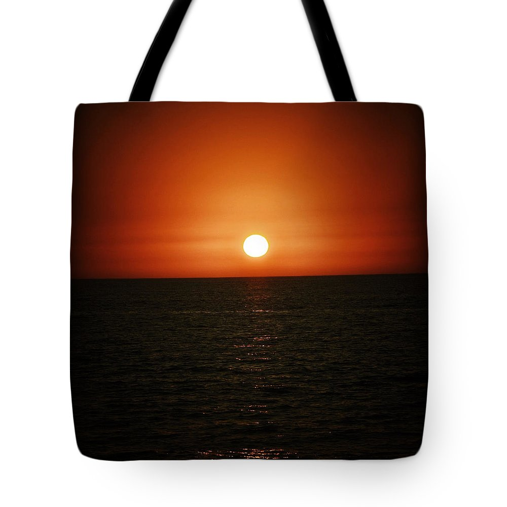 Ocean Tote Bag featuring the photograph The Setting Sun by Natasha Marco
